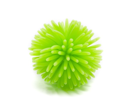 spikey: A plastic green Koosh stress ball with spikes all over it.