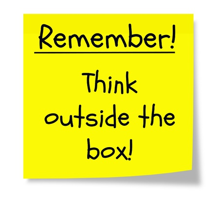 think out of the box: A yellow square sticky note wtih the words and concept remember to think outside the box.