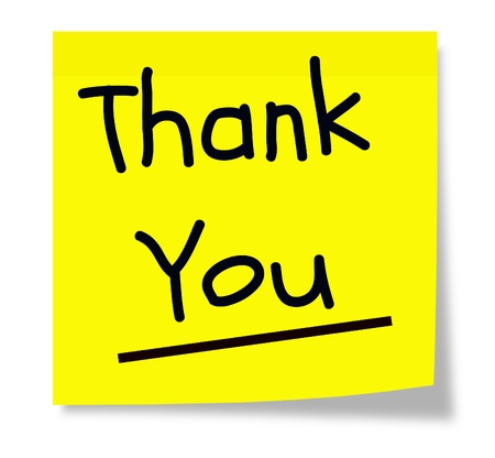 A square sticky yellow note pad with the words Thank You written in black.