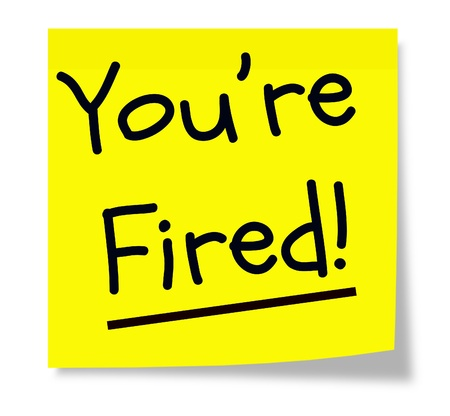 terminated: A yellow sticky memo pad note with black writing that says Youre Fired! Stock Photo