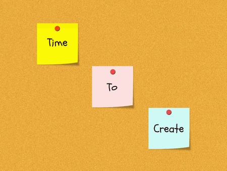 The words Time to Create on colorful sticky notes on a cork bulletin board wth red push pins. Stock Photo - 11597733