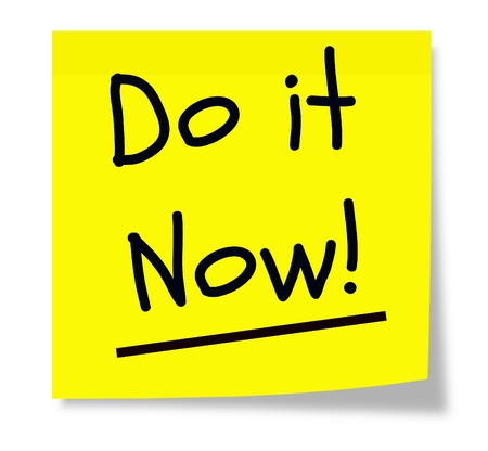 A yellow sticky pad with the words Do It Now written in black text making a great concept. Stock Photo - 11597706