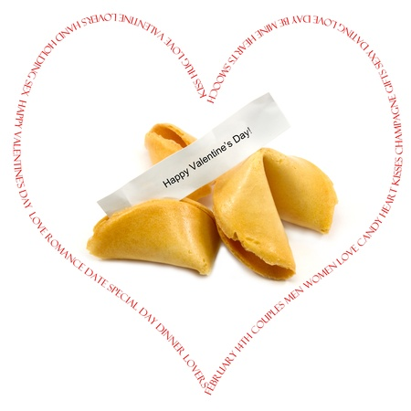 A heart shaped with words such as valentine, day, heart, kisses, hug, love, and more with fortune cookies inside that say happy Valentines Day. Stock Photo