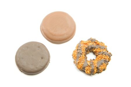 girl scout: Three Delicious Cookies that include a chocolate peanut butter, coconut ring, and a thin chocolate mint cookie that are sold door to door. Stock Photo