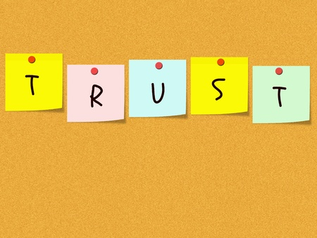 The word Trust spelled out on sticky notes in yellow, pink, blue, yellow and green on a cork bulletin board with red push pins. Stock Photo - 11804364