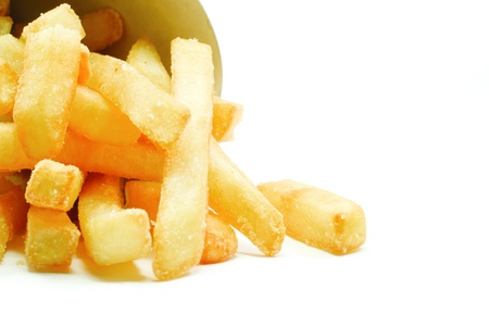 Big Thick Cut potato French Fries falling out of their cardboard container on white ready for your text. Stock Photo