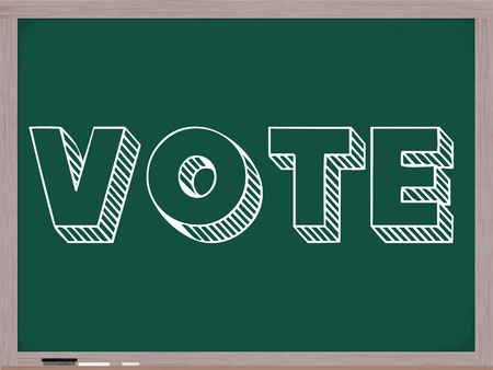 Vote written in big white letters on a chalkboard complete with wooden frame and eraser. photo