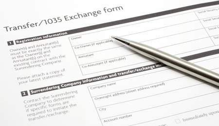 An annuity or investment Section 1035 Exchange Paper Form waiting to be filled out with a silver pen.