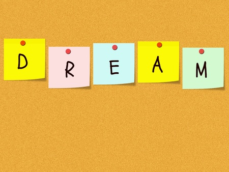 The word Dream spelled out on a corkboard with colorful sticky notes and red push pins. photo