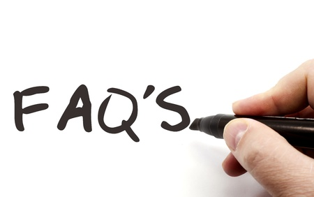 FAQs or frequently asked questions being written with a black marker on a dry erase board. Stock Photo