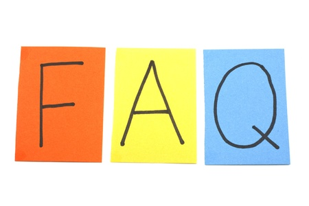 FAQ on Colorful Paper squares on a white background making a great frequently asked questions concept. photo