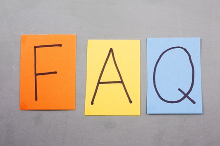 frequently asked questions: FAQ in colorful Letters on paper on a blackboard making a great concept. Stock Photo