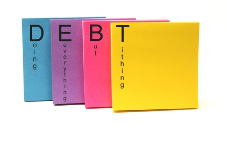but: Colorful sticky notes with DEBT doing everything but tithing do written on them.
