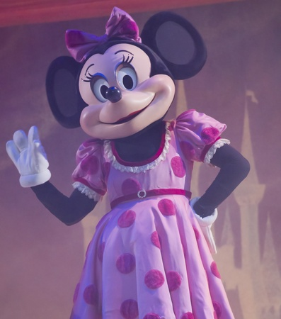 minnie mouse: GREEN BAY, WI - FEBRUARY 10: Minnie Mouse in a pink dress waves to the crowd at the Disney Princesses show at the Resch Center on February 10, 2012 in Green Bay, Wisconsin.