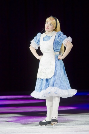 treasure trove: GREEN BAY, WI - MARCH 10: Alice in Wonderland in her blue dress and skates at the Disney on Ice Treasure Trove show at the Resch Center on March 10, 2012 in Green Bay, Wisconsin.