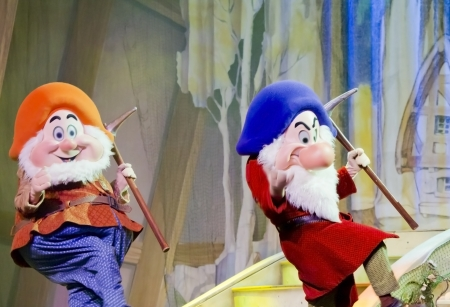 seven dwarfs: GREEN BAY, WI - FEBRUARY 10: Two Dwarfs from Snow White walking with mining picks at the Disney Princesses show at the Resch Center on February 10, 2012 in Green Bay, Wisconsin.