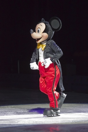 GREEN BAY, WI - MARCH 10: Mickey Mouse in red pants, black tuxedo tailsnress and skates at the Disney on Ice Treasure Trove show at the Resch Center on March 10, 2012 in Green Bay, Wisconsin.