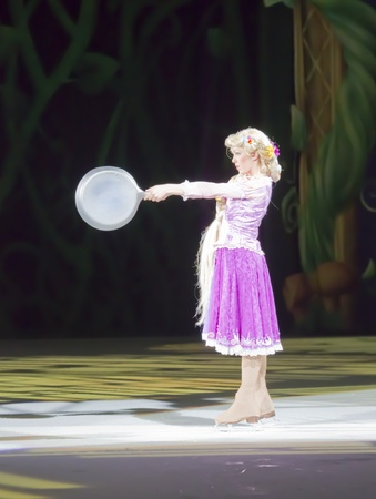 rapunzel: GREEN BAY, WI - MARCH 10: Rapunzel from Tangled with a frying pan on skates at the Disney on Ice Treasure Trove show at the Resch Center on March 10, 2012 in Green Bay, Wisconsin. Editorial