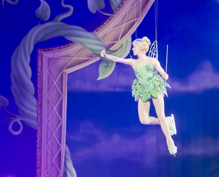 tinker bell: GREEN BAY, WI - MARCH 10: Tinker Bell from Peter Pan flies high above the ice the Disney on Ice Treasure Trove show at the Resch Center on March 10, 2012 in Green Bay, Wisconsin.