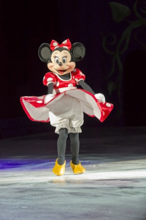 GREEN BAY, WI - MARCH 10: Minnie Mouse in a red or pink dress, yellow shoes and skates at the Disney on Ice Treasure Trove show at the Resch Center on March 10, 2012 in Green Bay, Wisconsin.
