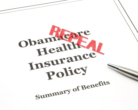 Repeal stamped in red onObamacare government health care insurance program policy with a pen ready.