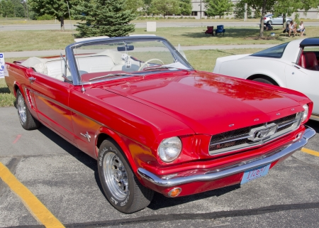 18th: APPLETON, WI - JULY 21:  A beautiful red Ford Mustang convertible car at the 18th Annual WVBO Classic Car Show and Cruise at Fox Valley Technical College on July 21, 2012 in Appleton, Wisconsin. Editorial