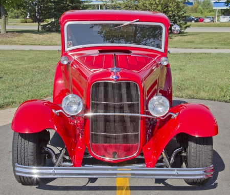 APPLETON, WI - JULY 21:  The front of a beautiful red Ford Hot Rod car at the 18th Annual WVBO Classic Car Show and Cruise at Fox Valley Technical College on July 21, 2012 in Appleton, Wisconsin.