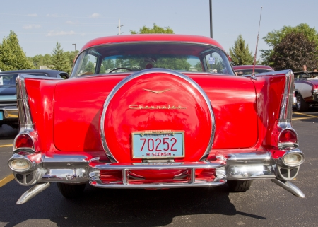 APPLETON, WI - JULY 21: Back view Red 1957 Chevy Chevrolet Bel Air Two Door at the 18th Annual WVBO Classic Car Show and Cruise at Fox Valley Technical College on July 21, 2012 in Appleton, Wisconsin. Stock Photo - 14542556