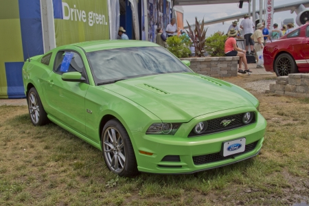 OSHKOSH, WI - JULY 27: A 2012 Green Ford Mustang car on display at the Ford exhibit at the 2012 AirVenture at EAA on July 27, 2012 in Oshkosh, Wisconsin.