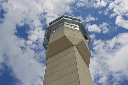 OSHKOSH, WI - JULY 27: A view from the base of the Air traffic control tower against the beautiflul blue and cloud sky at the 2012 AirVenture at EAA on July 27, 2012 in Oshkosh, Wisconsin.