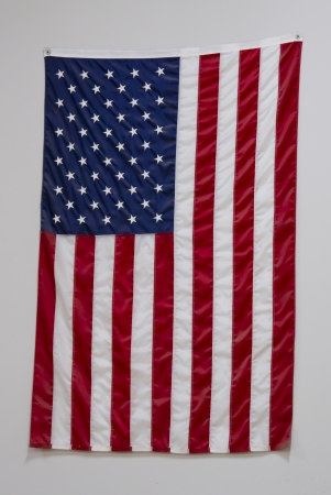A big American flag in a gymnasium at a school hanging on a wall Stock Photo - 14742683