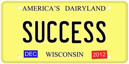 Een imitatie Wisconsin kenteken van december 2012 stickers en SUCCES geschreven op het maken van een geweldig concept. Stockfoto