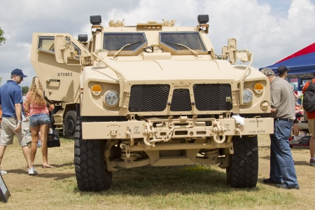 OSHKOSH, WI - JULY 27:  An Oshkosh Corp Humvee vehicle as used in the military on display the 2012 AirVenture at EAA on July 27, 2012 in Oshkosh, Wisconsin.