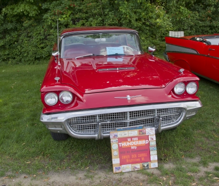 thunderbird: COMBINED LOCKS, WI - AUGUST 18:  Front view of a red 1960 Ford Thunderbird or T-Bird classic car at the 2nd Annual Horizon of Hope Generations Car and Truck Show on August 18, 2012 in Combined Locks, Wisconsin.