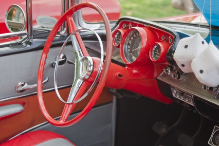 COMBINED LOCKS, WI - AUGUST 18:  Steering Wheel and dash of an orange 1957 Chevy convertible classic car at the 2nd Annual Horizon of Hope Generations Car and Truck Show on August 18, 2012 in Combined Locks, Wisconsin.