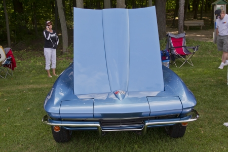 COMBINED LOCKS, WI - AUGUST 18: Front view of a blue 1965 Chevy Corvette classic car at the 2nd Annual Horizon of Hope Generations Car and Truck Show on August 18, 2012 in Combined Locks, Wisconsin.