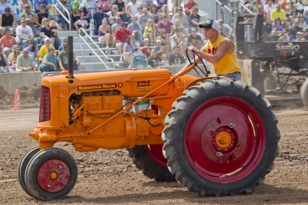 DE PERE, WI - AUGUST 18: A red & orange Minneapolis Moline tractor competing at the Tractor Pull event at the Brown County Fair on August 18, 2012 in De Pere, Wisconsin.
