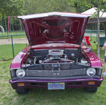 COMBINED LOCKS, WI - AUGUST 18: Front view of a purple 1969 Chevy Nova SS classic car at the 2nd Annual Horizon of Hope Generations Car and Truck Show on August 18, 2012 in Combined Locks, Wisconsin.