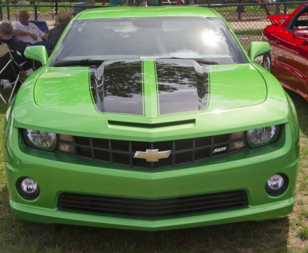antique car: COMBINED LOCKS, WI - AUGUST 18: Front view of a green and black Chevy Camaro car at the 2nd Annual Horizon of Hope Generations Car and Truck Show on August 18, 2012 in Combined Locks, Wisconsin.