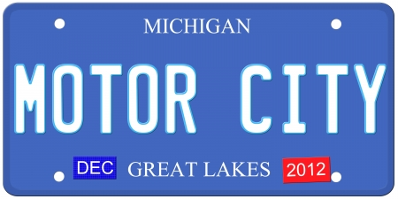An imitation Michigan license plate with December 2012 stickers and Motor City written on it making a great Detroit or Michigan auto concept.  Words on the bottom Great Lakes. photo