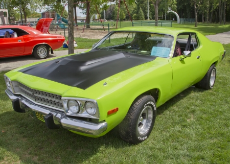 COMBINED LOCKS, WI - AUGUST 18: 1973 Plymouth Satellite classic car at the 2nd Annual Horizon of Hope Generations Car and Truck Show on August 18, 2012 in Combined Locks, Wisconsin.