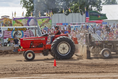 DE PERE, WI - AUGUST 18: A red Allis-Chalmers tractor pulling weights past us at the Tractor Pull event at the Brown County Fair on August 18, 2012 in De Pere, Wisconsin.