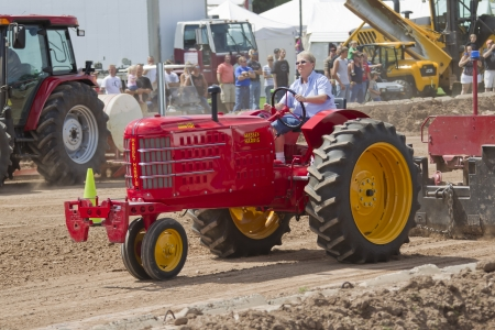 DE PERE, WI - AUGUST 18: A red Massey Harris Super 101 Tractor competing at the Tractor Pull event at the Brown County Fair on August 18, 2012 in De Pere, Wisconsin.