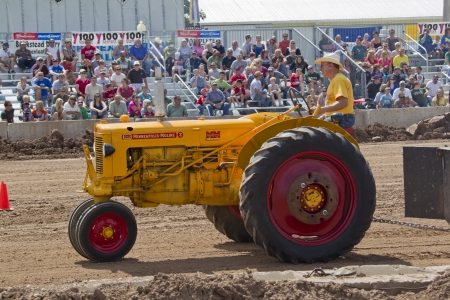 DE PERE, WI - AUGUST 18: A yellow Minneapolis Moline Tractor competing at the Tractor Pull event at the Brown County Fair on August 18, 2012 in De Pere, Wisconsin.