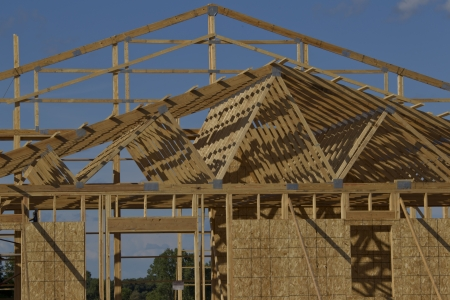 rafters: Wooden rafters and framing on a building being constructed and in its framing process. Stock Photo
