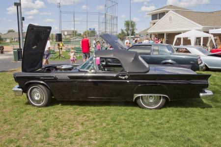 thunderbird: COMBINED LOCKS, WI - AUGUST 18: 1957 Ford Thunderbird black classic car at the 2nd Annual Horizon of Hope Generations Car and Truck Show on August 18, 2012 in Combined Locks, Wisconsin.