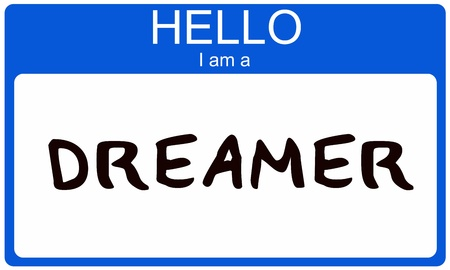 A blue nametag sticker with the words Hello I am a Dreamer written on it making a great concept image. Stock Photo - 14947316