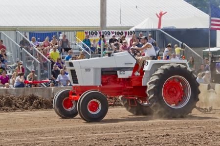 DE PERE, WI - AUGUST 18: A Case 1070 Orange & White Tractor competing at the Tractor Pull event at the Brown County Fair on August 18, 2012 in De Pere, Wisconsin.