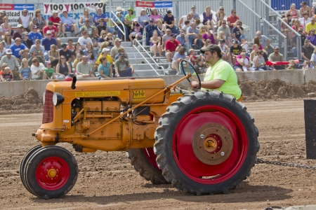 DE PERE, WI - AUGUST 18: A Minneapolis Orange & Red Tractor competing at the Tractor Pull event at the Brown County Fair on August 18, 2012 in De Pere, Wisconsin.