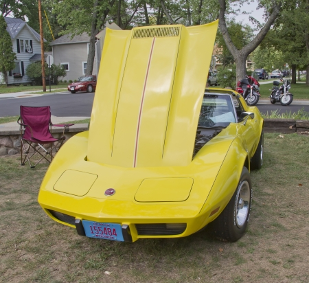 WAUPACA, WI - AUGUST 25: Bright yellow 1975 Corvette Stingray classic car at the 10th Annual Waupaca Rod & Classic Car Club Car Show on August 25, 2012 in Waupaca, Wisconsin. Stock Photo - 14985857